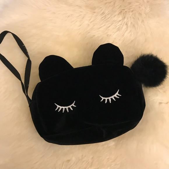 Urban Outfitters Handbags - NWOT Eyelash Pom Zip Velvet Pouch Makeup Bag